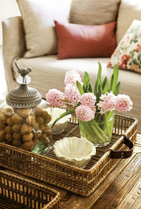 A simple wicker tray is just the right touch to create a gentle coastal inspired vignette.