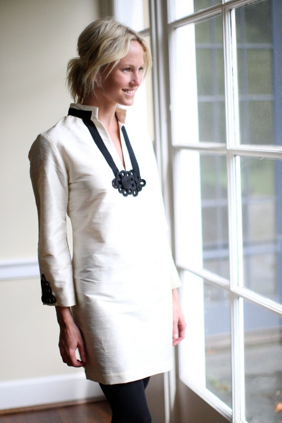 This white tunic is refined, simple, elegant and has a classic twist. From work to evening this tunic transitions perfectly. Image via Devon Baer Design.