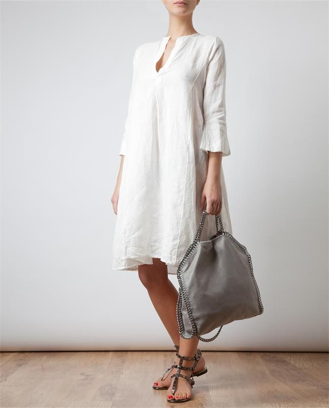 Perfect on a hot summer's day whether walking to work or a  stroll along the avenue this simple white linen tunic complements any age and flatters every figure.