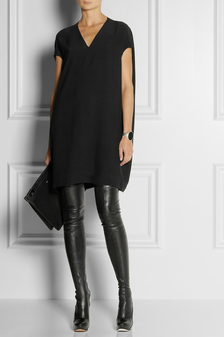 This tunic from  The Daily Chic  is hip and stylish. Worn with thigh high boots this tunic is also quite edgy.