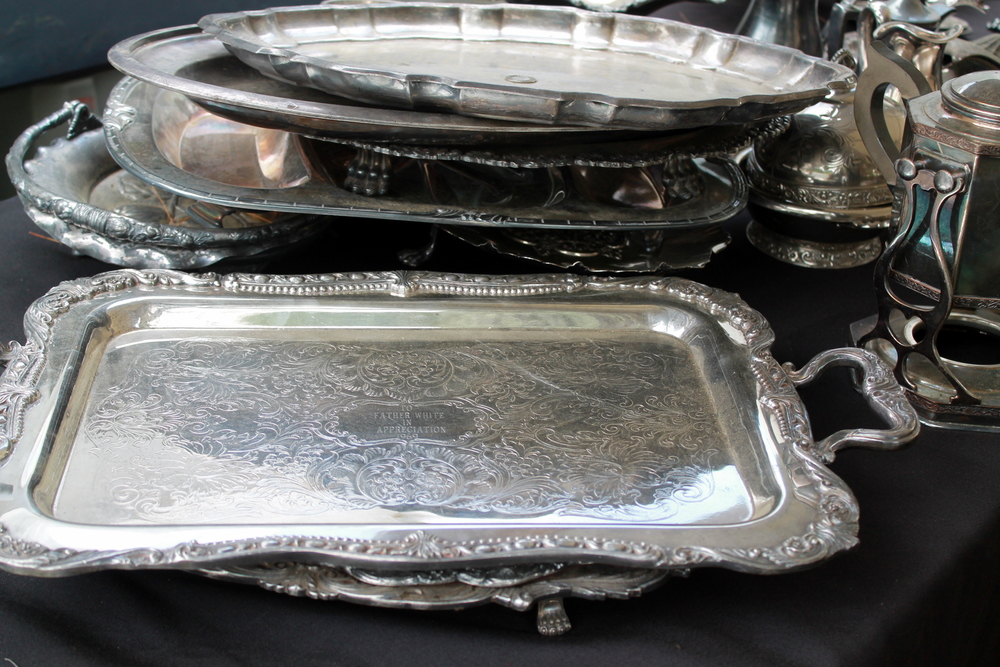 One can never have too many silver trays. In a bedroom or guest room - A perfect platform for a vase filled with flowers, a few bottles of perfume and a candle. If on a budget look for a silver plate tray to dress up any space.