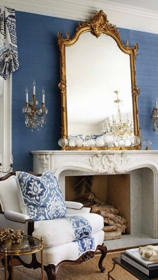 The blue grasscloth walls and white trim becomes quite formal and elegant when accented with gold. Image via Tumblr.
