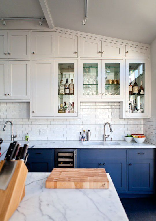 Blue offers the perfect bold pop of color against the clean white background of this modern kitchen.