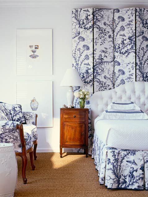 Blue and white chinoiserie accented by crisp white and rich woods create a soothing, elegant bedroom. Image via The Glam Pad.