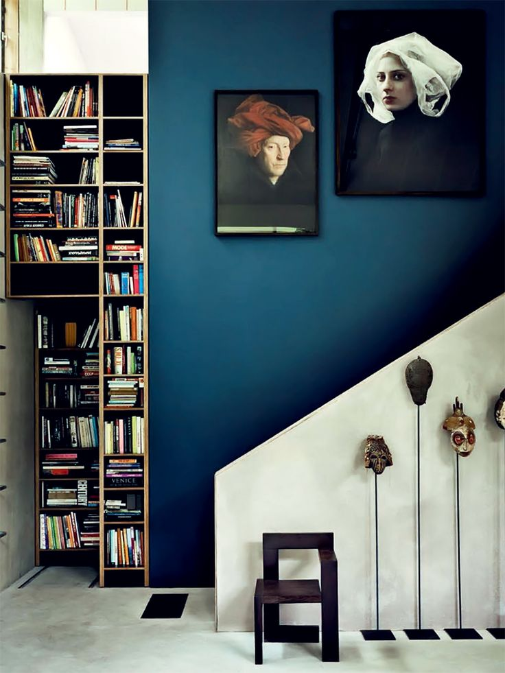 Urban and Lofty. An indigo wall gives this modern space with clean lines personality and depth. Image via Decor8