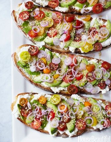 This vegetarian sandwich from chef Gabrielle Hamilton for  House Beautiful  is a perfect bite on a warm summer day.... heirloom tomatoes, onions, ricotta, lemon avocados and a hearty bread... It doesn't get more simple than that!