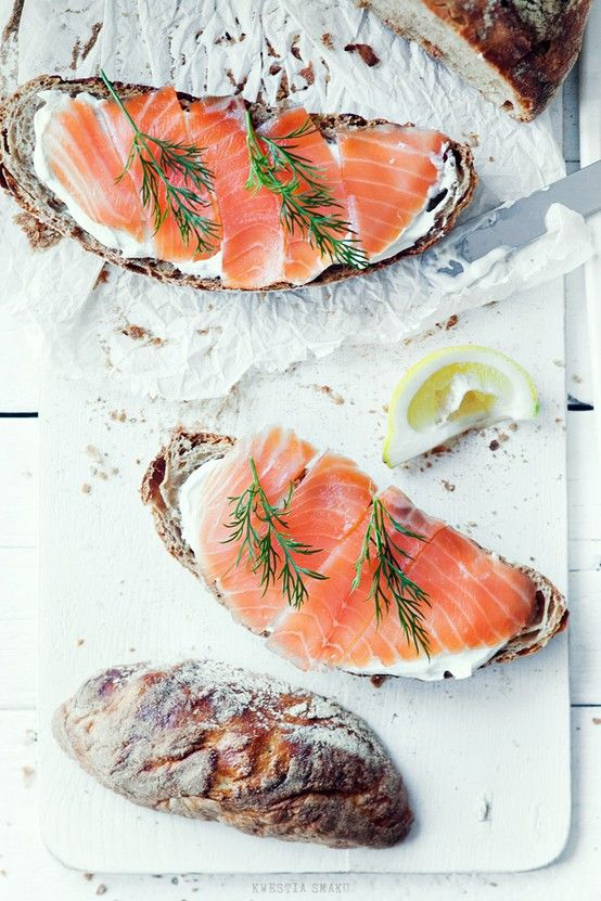 Smoked salmon, and a good crusty bread is never a bad thing. A dab of soft creamy cheese, some lemon and dill and I could live on this all day. There are many variations and many different breads may be used.  Image via  Kwestia Smaku.