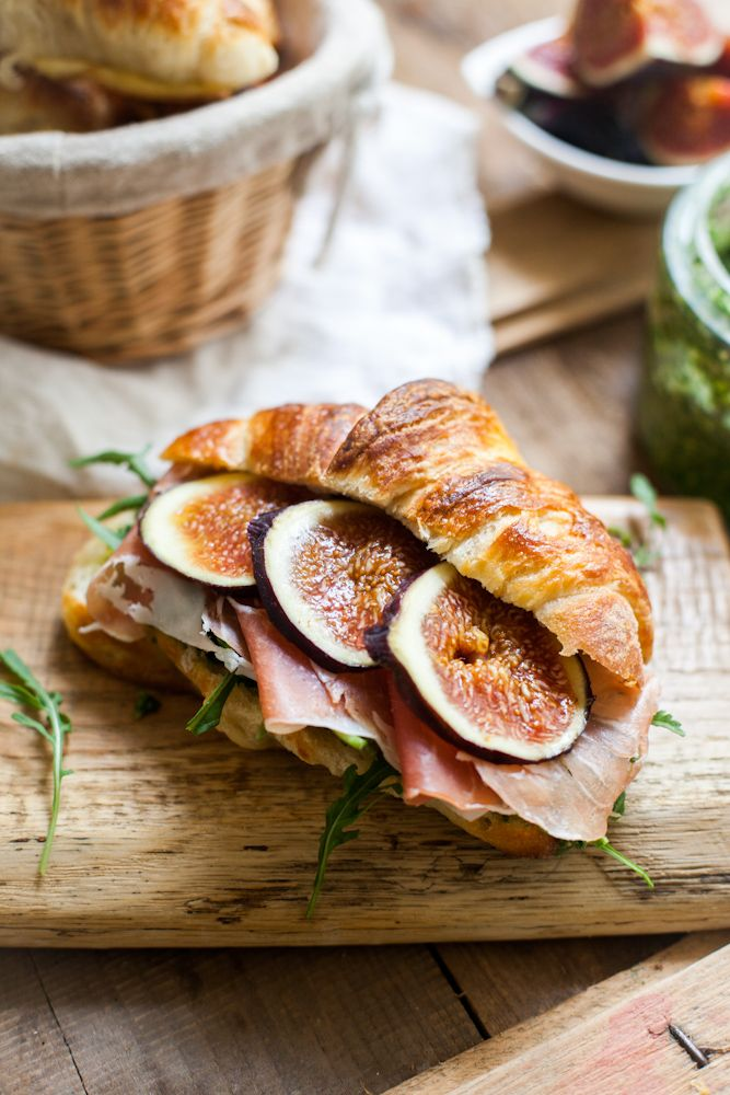 For those who likes sweet and savory, fresh figs and prosciutto, arugula and ricotta on a tender flaky croissant will delight and satisfy. Image via Relish Catering.