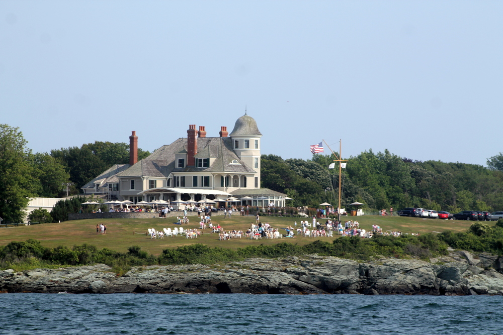 Sailing in Newport. The iconic Inn at Castle Hill stands majestically in the background. Image via Jessica Gordon Ryan
