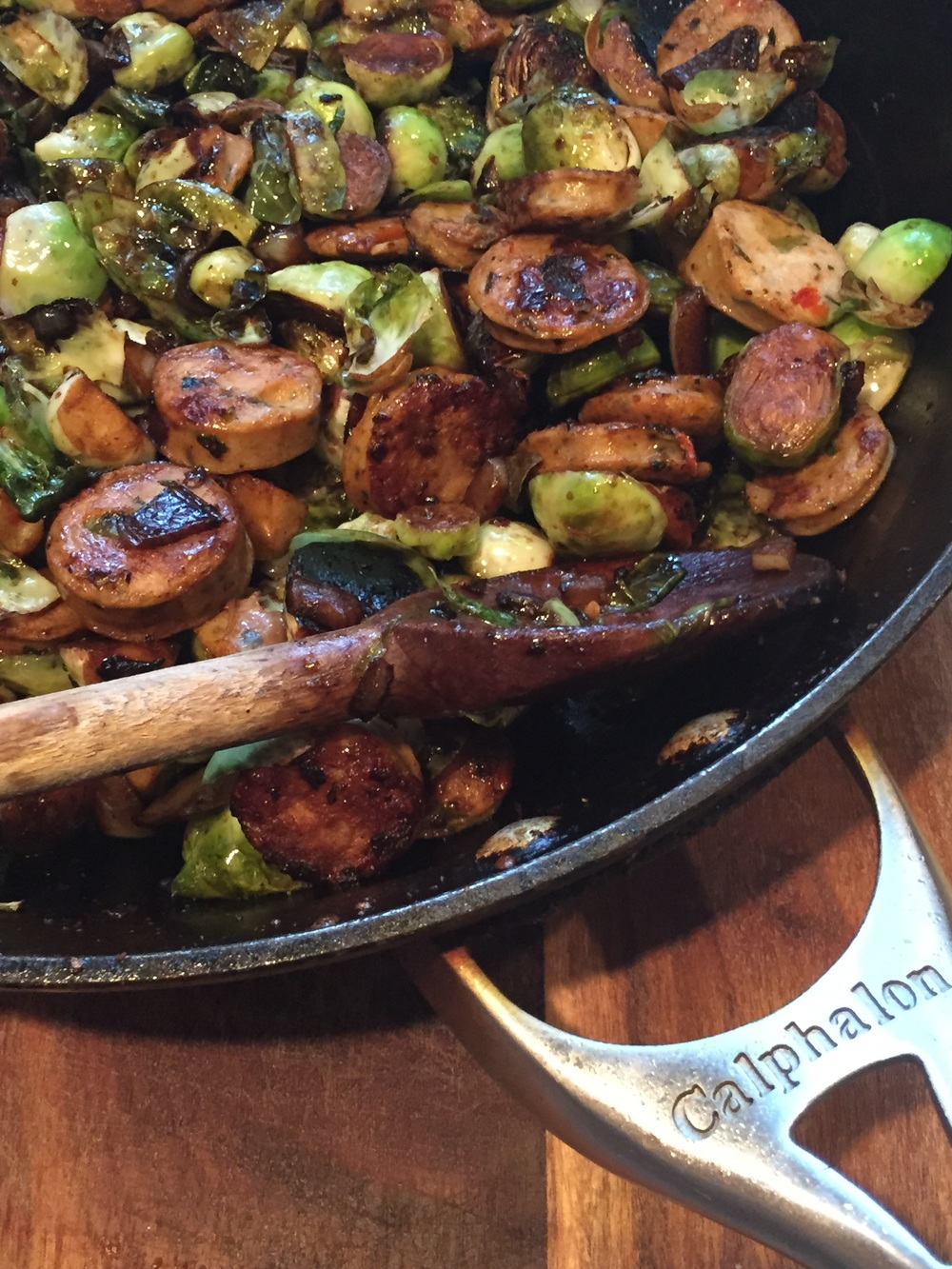 Sausages and Brussels Sprouts in Balsamic Vinegar. Image via The Entertaining House