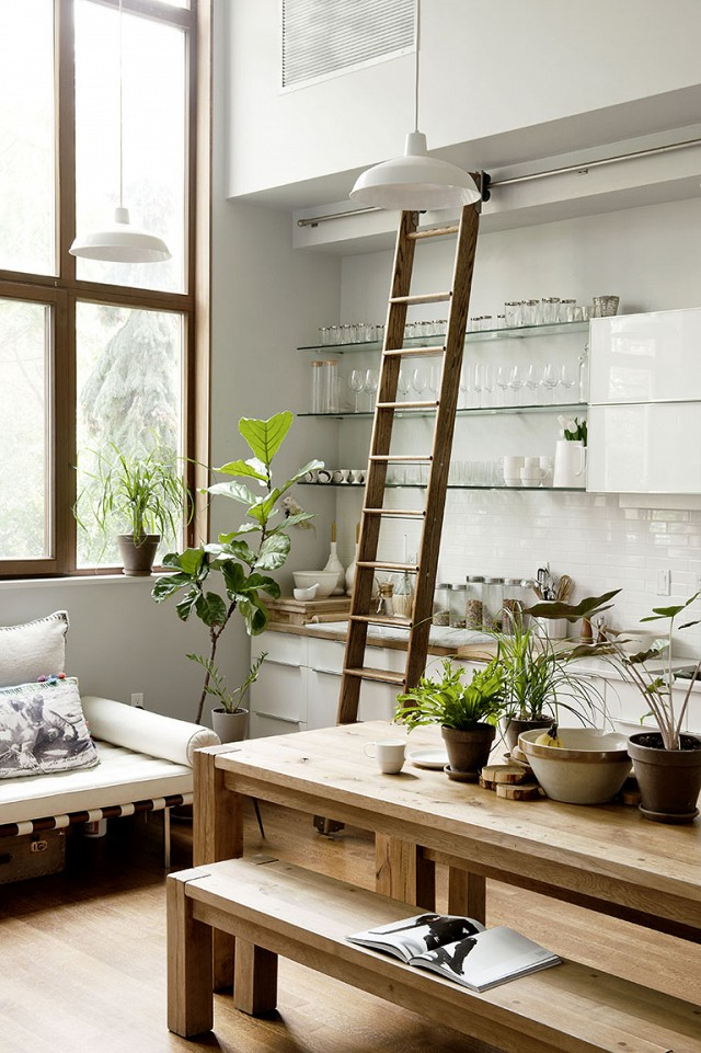 The many uses for the library ladder in the home. Image via Domaine