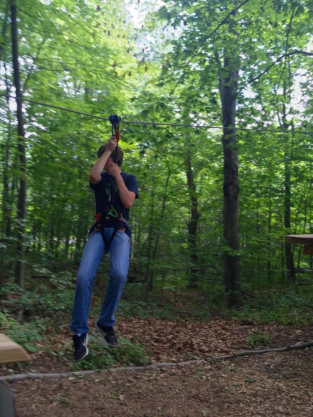 Go Ape Review. The Entertaining House. All images shot with iPhone 6. Christopher on the Level 1 zip line.