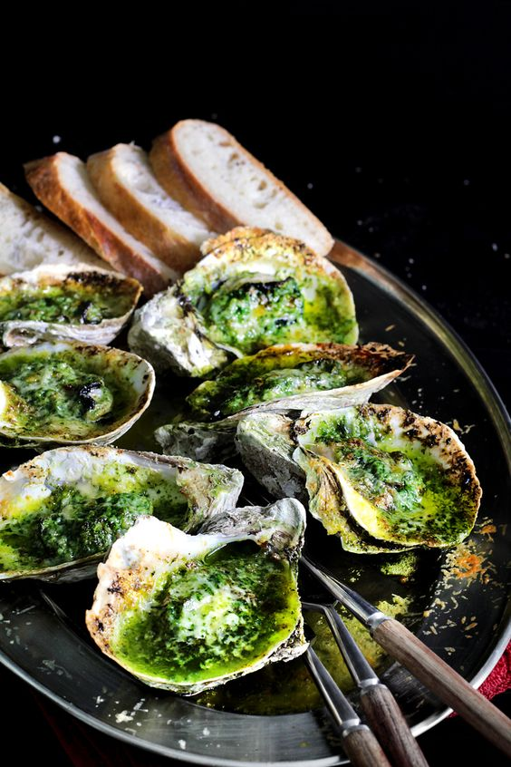 Stylish Bites :: Celebrating National Oyster Day. Image via Jessica Gordon Ryan/The Entertaining House - Grilled oysters with green butter... Recipe from  Lady and Pups .