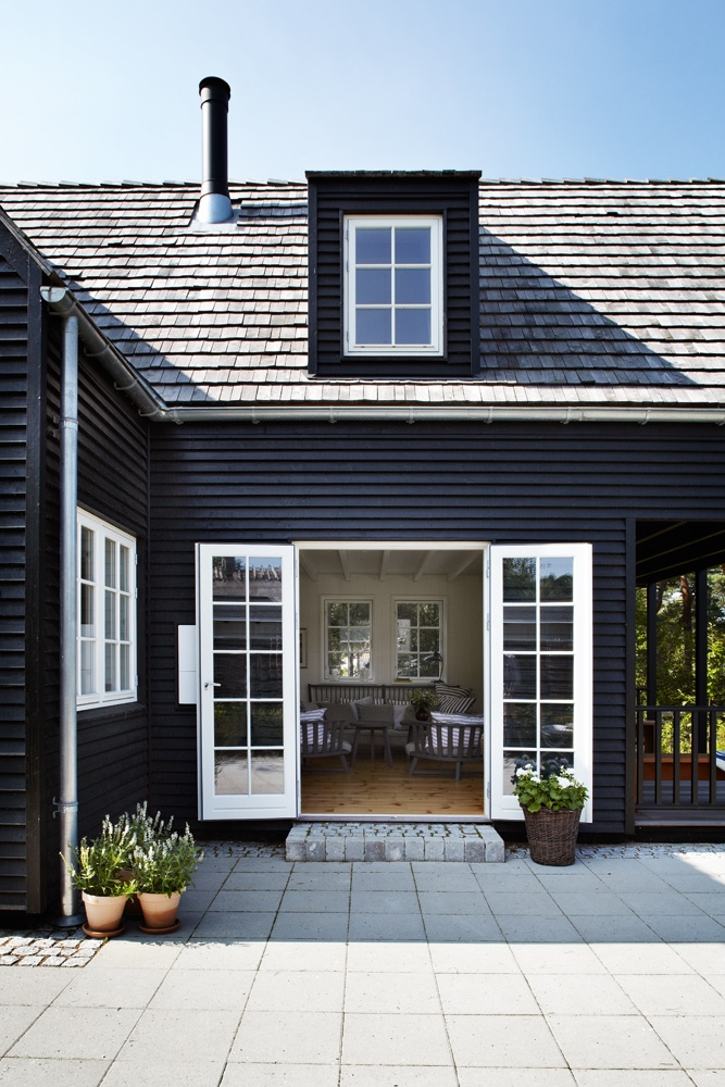 Little Black Houses - Image via  Posh Home
