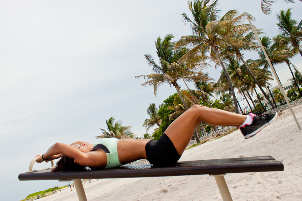 Lay on your back with your feet and knees together.  Raise you legs over the surface, knees slightly bent, using your abs to hold them there. This will be your starting position.