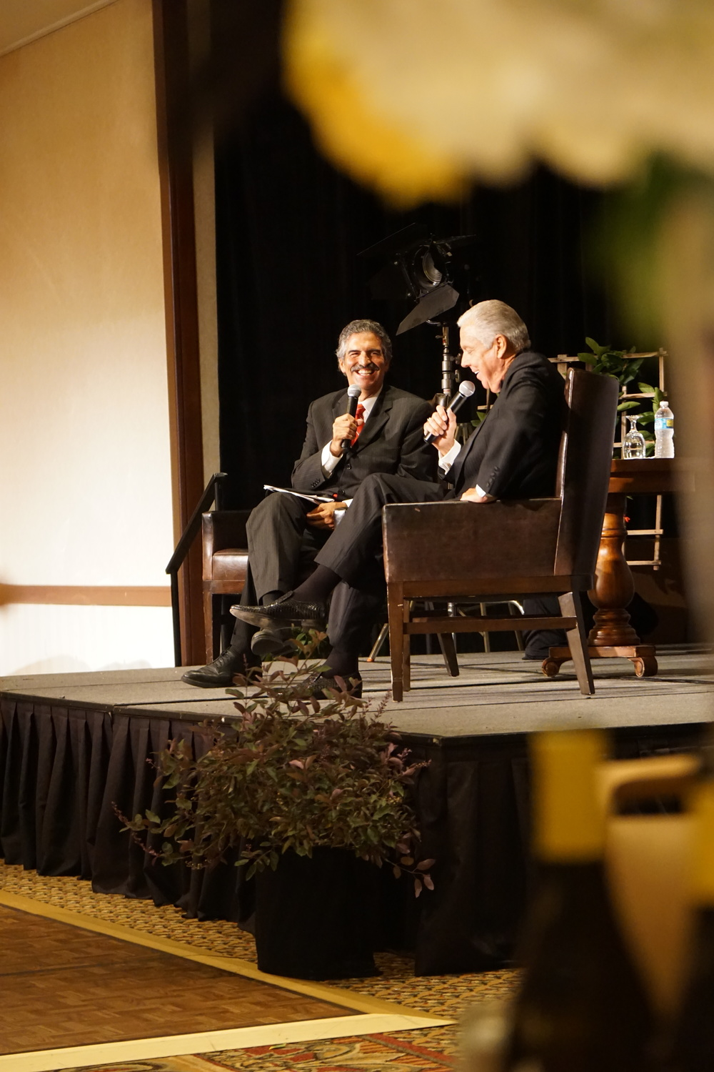Newscaster John Palminteri interviewing Barry Meguiar during the Q & A session at gala event.
