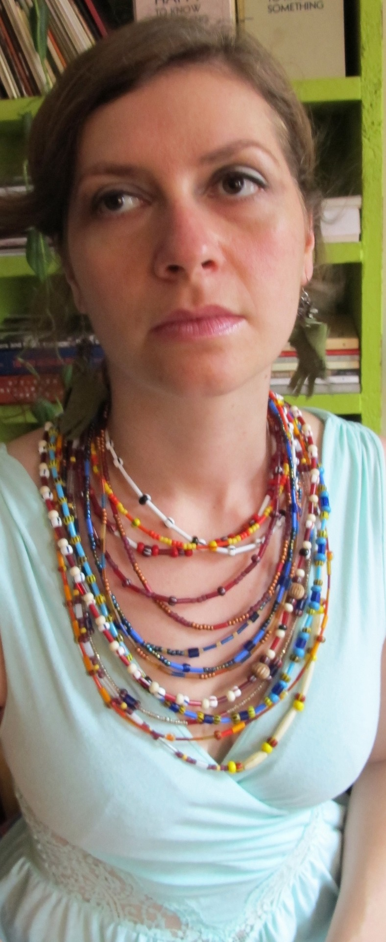 "Elaine Kahn is Glutton The Sestina and makes a ""fair faced""  jewelry  model with her ""lively stand."""