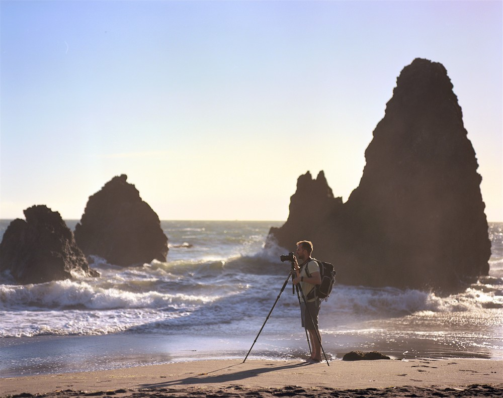 My friend Eric borrowing my tripod to get in on the Rodeo Beach action