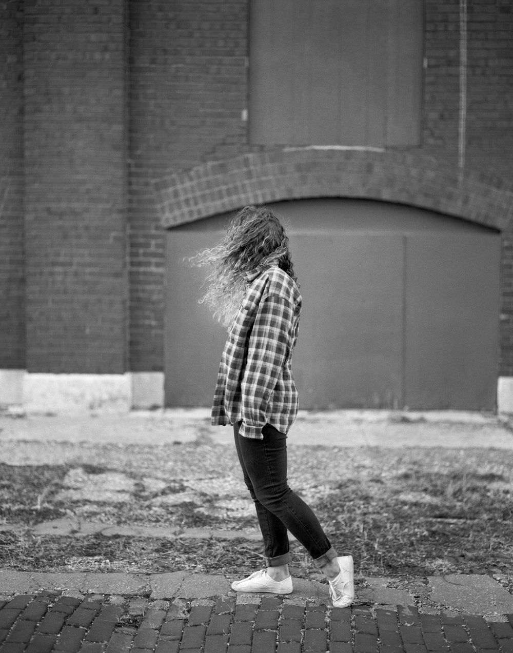 I really enjoyed working with the wind on the location. We were walking when I looked over at Jo and noticed her natural stride made for a cool pose.