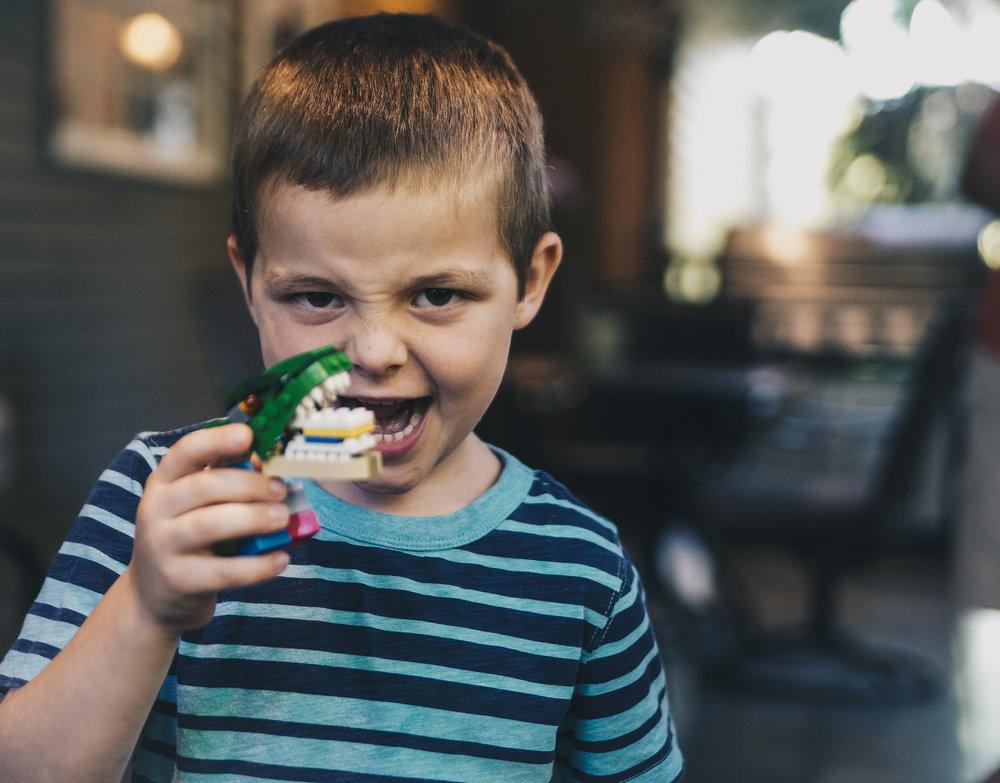 Boy holding up model teeth