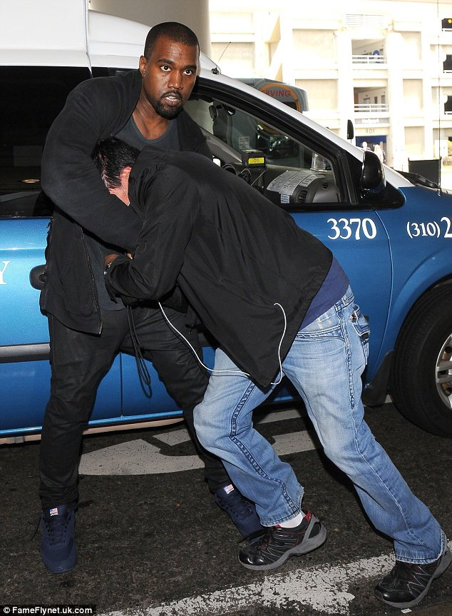 Kanye West papparazzi fight