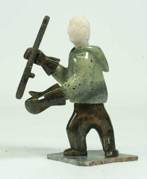 Pitseolak Oshutsiaq 7041I Hunter with Rifle, 2015 Serpentinite, Marble h 7 x w 3 d 5 in