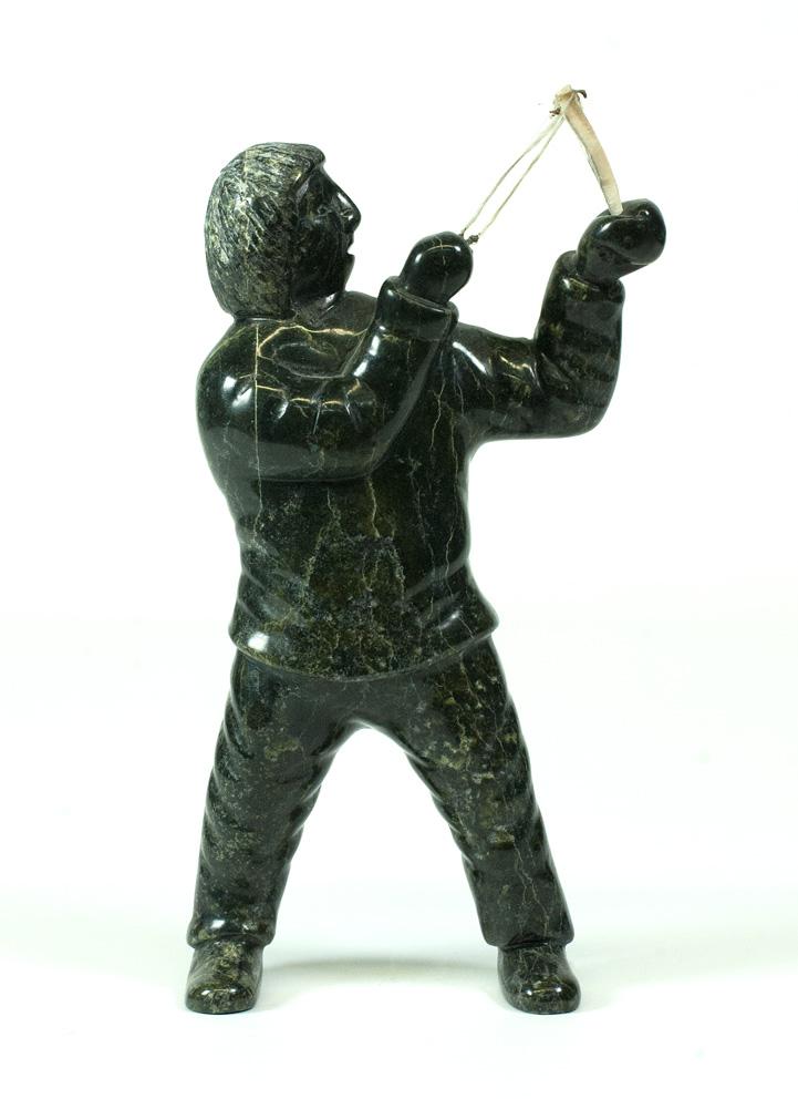 "7570E  Isaaci Etidloie Boy with Sling Shot, 2010 serpentinite, antler, sinew H 8"" W 4"" D 1.5"""
