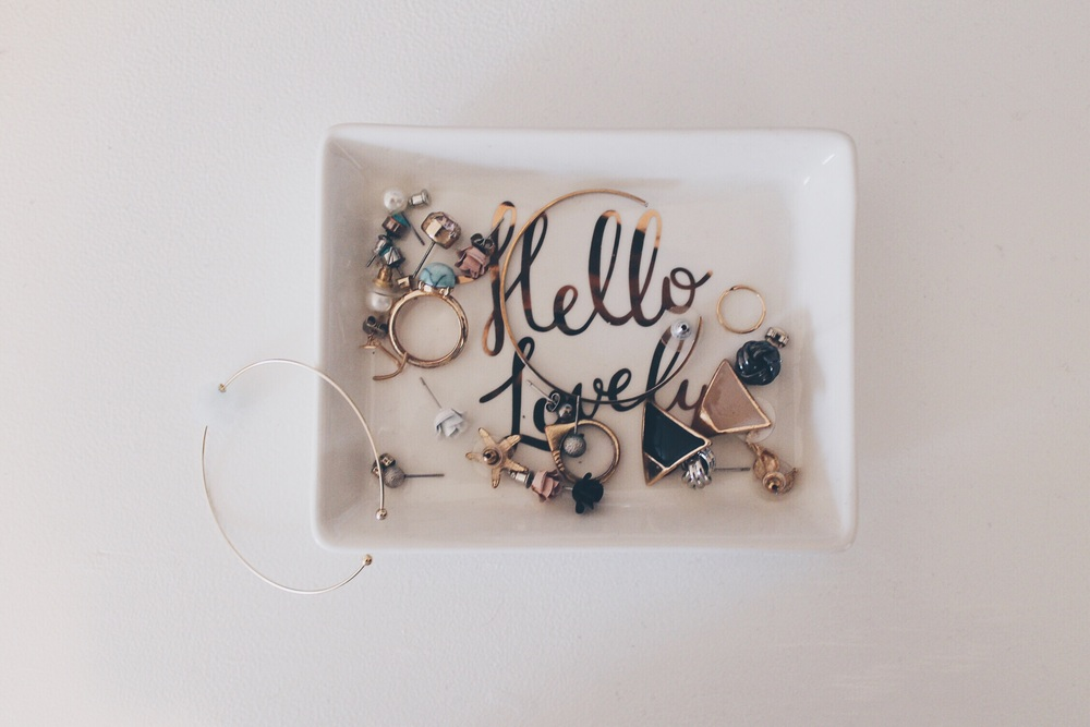 I love the look of a simple plate to hold small jewellery items. It's functional and serves as an accent