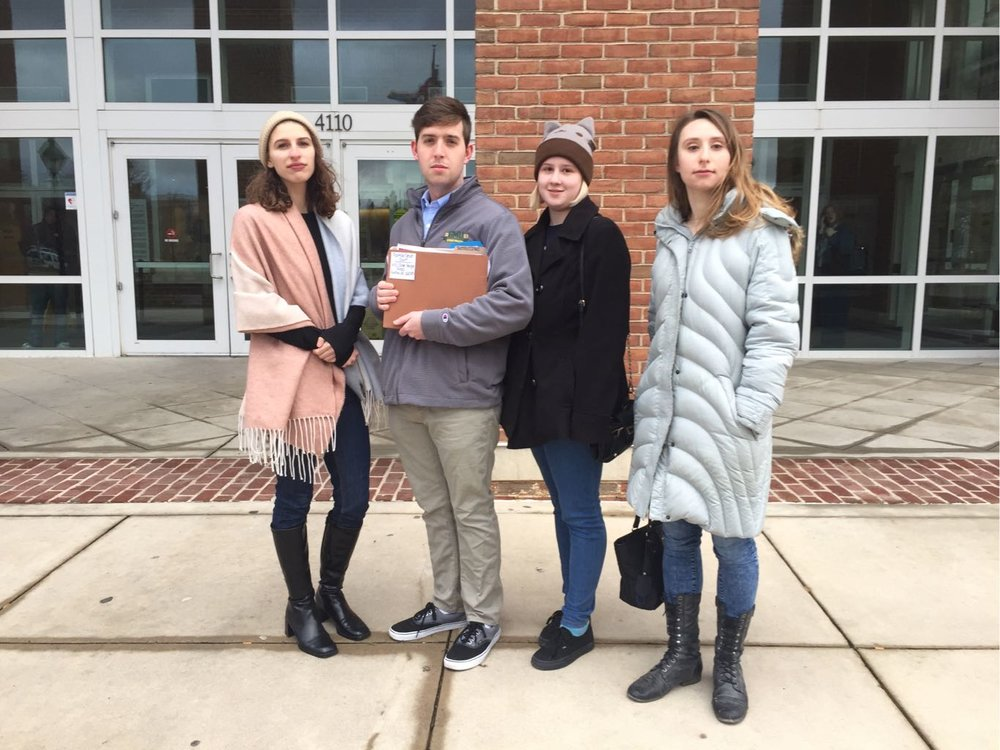 See  press release  and  legal petition  here. Students: Janine Gaspari, Gus Thomson, Molly Reagan, and Liz Mathews deliver a legal complaint to the Fairfax County Court #squadgoals #transparency