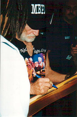 Willie Nelson signs my mountain dulcimer backstage at the Ruth Eckerd Center in Clearwater, Florida - 1996