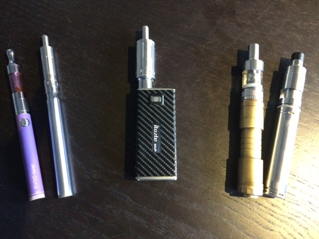 My gear.  From left to right: EVOD-twist variable voltage battery with Kanger Mini Protank 3 atomizer; eGo-C Twist variable voltage battery with Kanger Aerotank Mini atomizer; iTaste MVP 2 variable voltage/wattage box mod with Kanger Aerotank Mega atomizer; Sentinel M16 telescoping mechanical mod with Aspire Atlantis atomizer; Stingray 803 mechanical mod with Fogger v4 rebuildable atomizer.