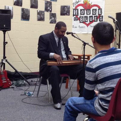 David Kimbrough III performing  on mountain dulcimer for a Blues In The Schools program at McNair Middle School in Fayetteville, Arkansas