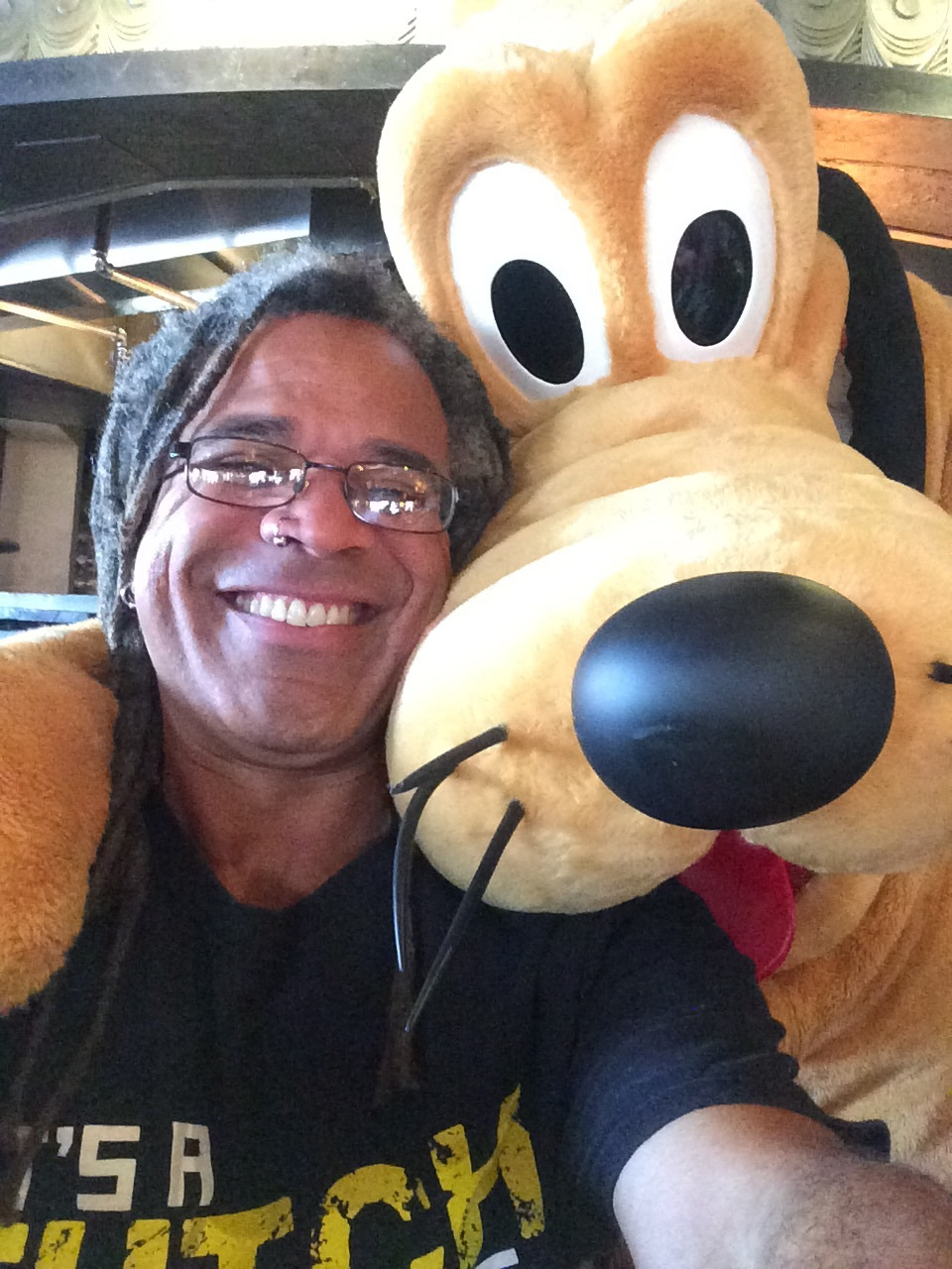 I won't stop sharing pics like this, but it will happen a lot less often. Me and Pluto on Boxing Day at Disney's Polynesian Resort.