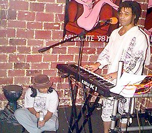 Performing on a Kawai K-1 at Java Jabbers in Orlando, Florida circa 1998. Monica Rabino is playing tambourine.
