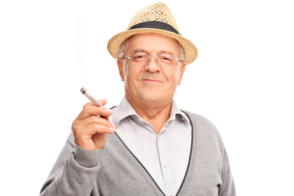 Yes, that's a joint.  I wanna grow up to be a cool old dude like this!