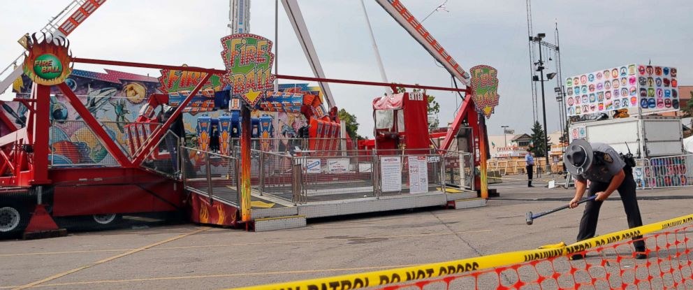 A Columbus police officer secures a perimeter around the Fireball at the Ohio State Fair.
