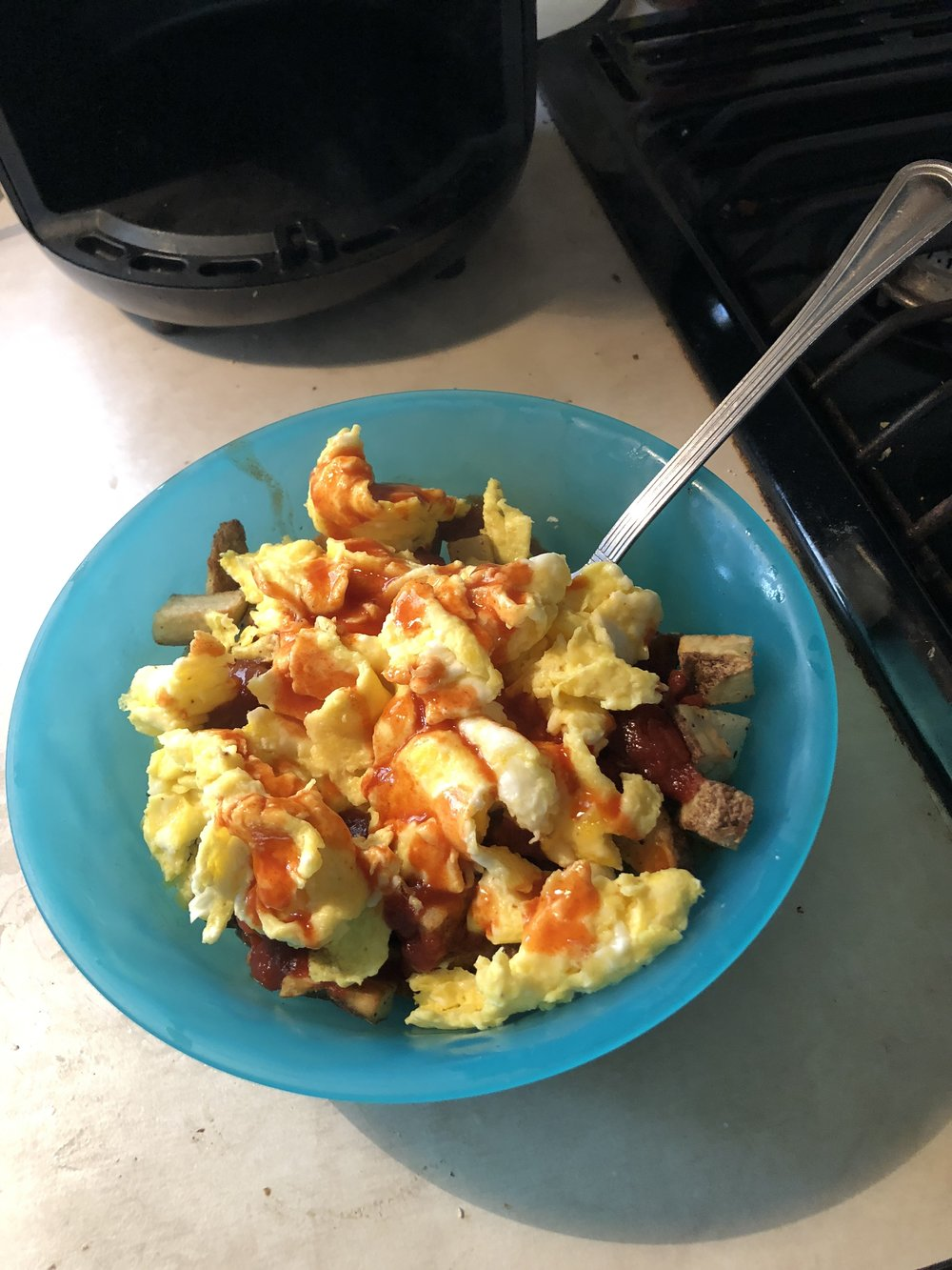 Fresh cut home fries with jalapeño ketchup and eggs with hot sauce: breakfast of itinerant dulcimer dreadies.