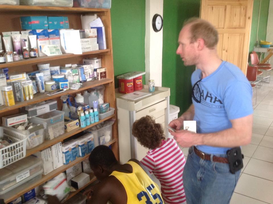 stocking of shelves with the help of a visiting medical team