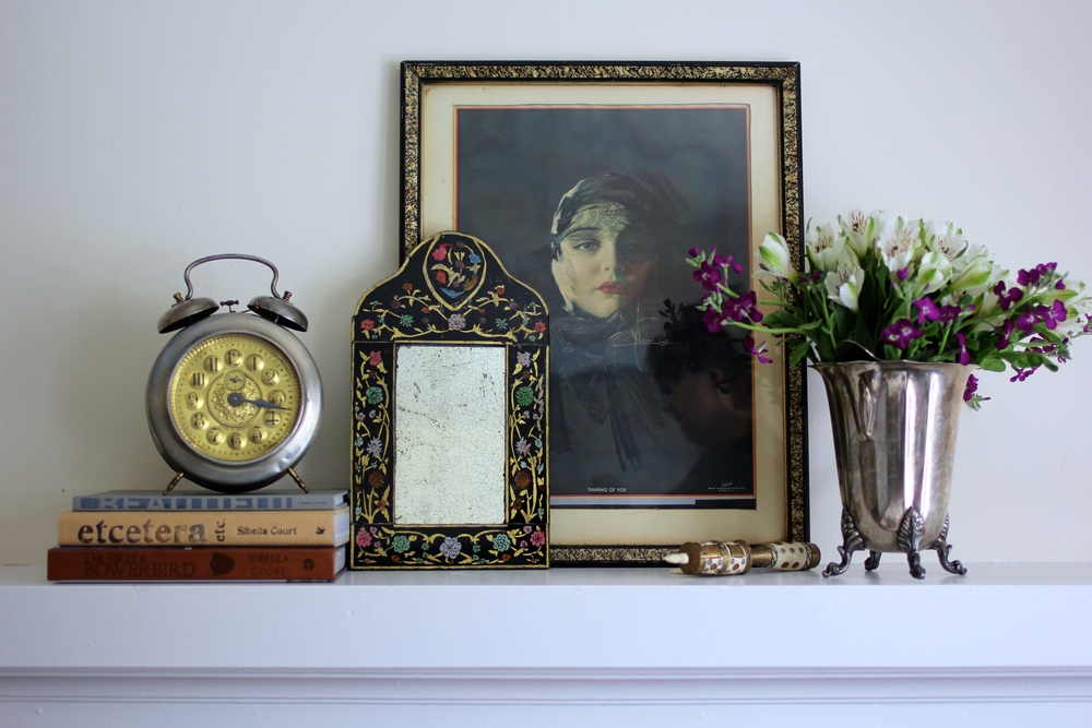 Photos and Mirrors over a mantle fireplace