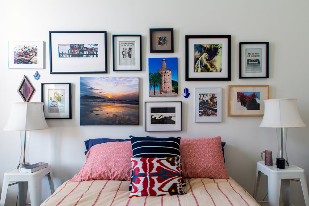 Bedroom design with framed photo wall