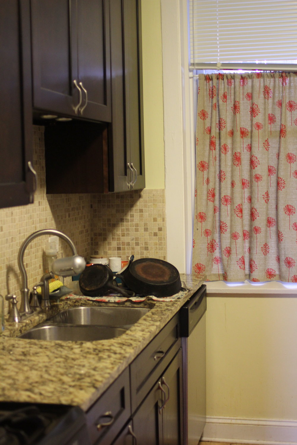 Granite Countertops and pots and pans in kitchen