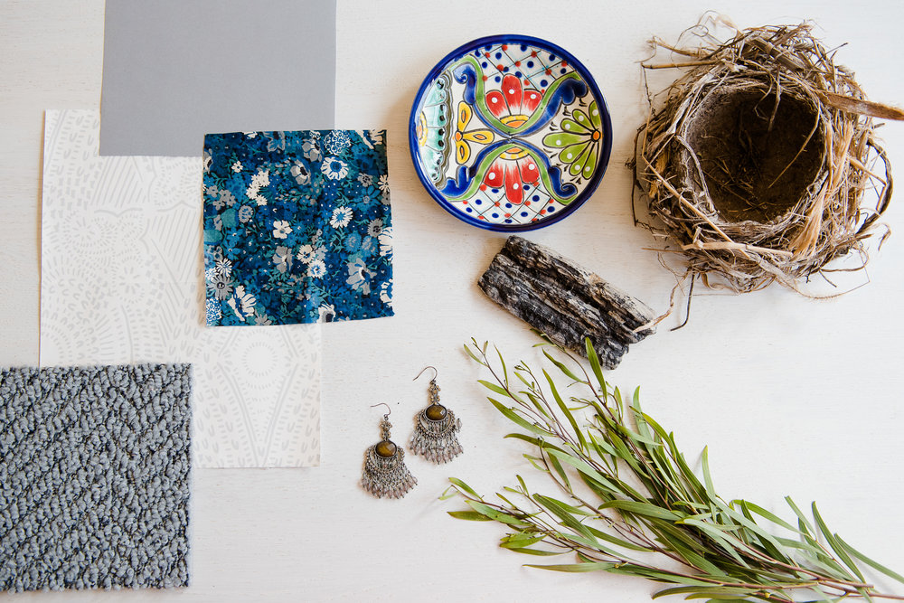 Mood Board of fabric, jewelry, dishes, and flowers