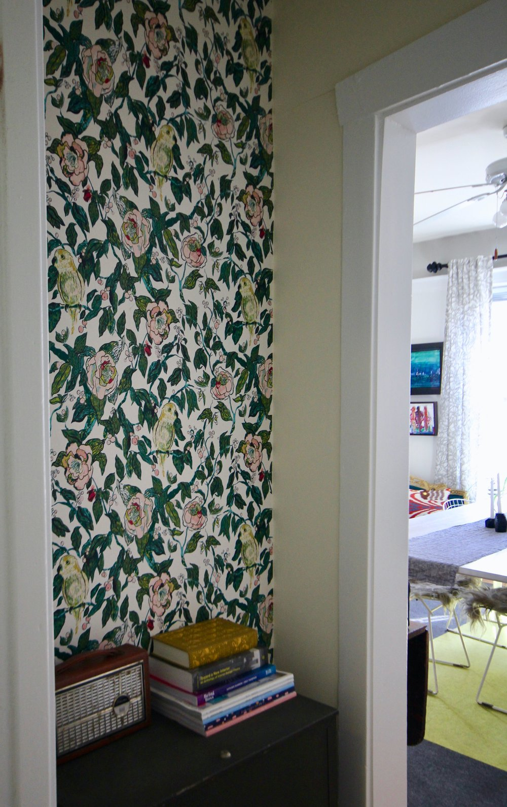 Floral wall paper in entry way of home design