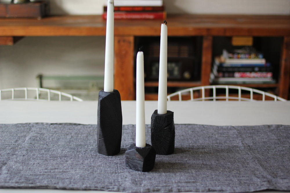 candlesticks on top of dining room table