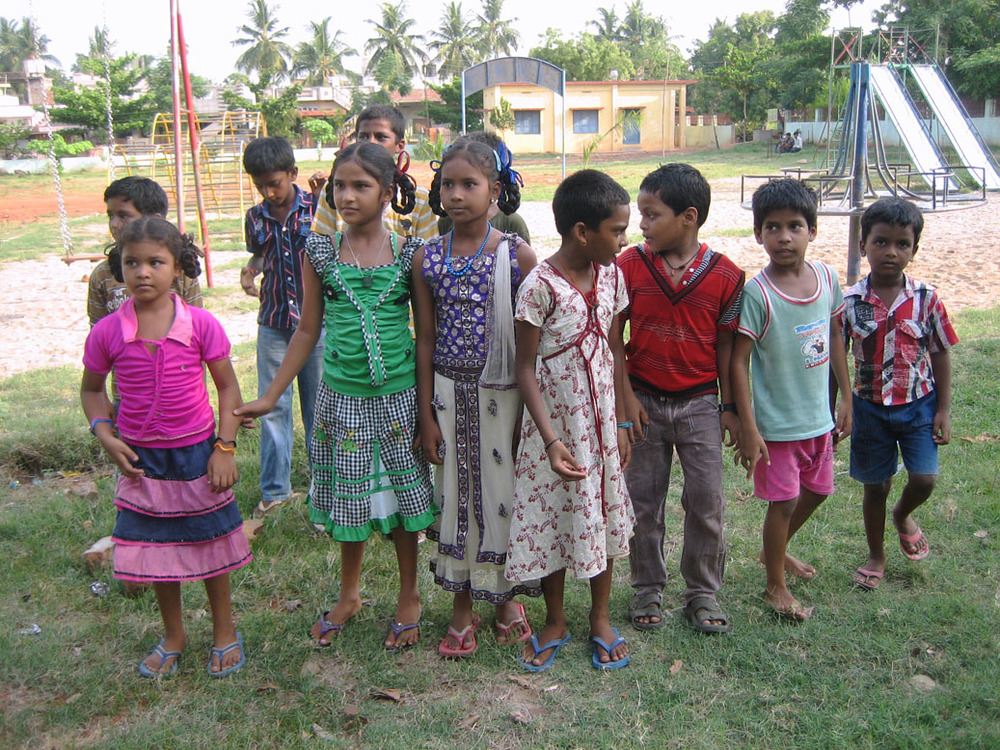 Hanging out at the playground beside Pastor Kumar's house