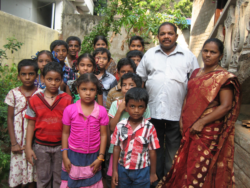 Pastor Kumar, his wife Mani, and the children of Faith Children Home