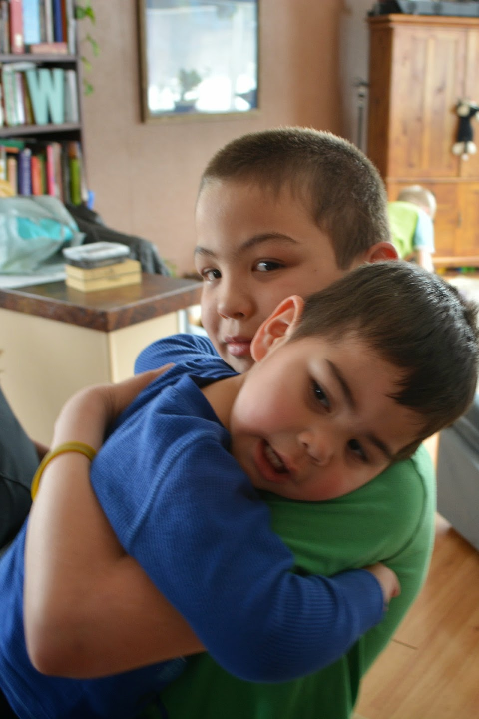 Levi gives his brother Quinton a cuddle.