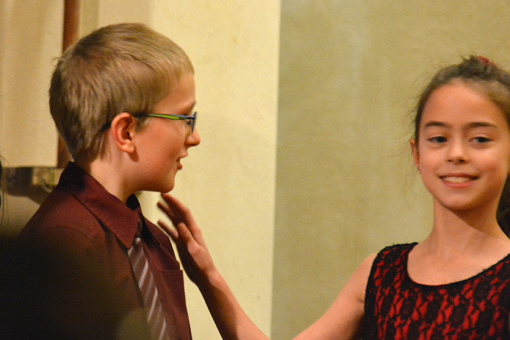 Jabin at a school choir performance last week. He wouldn't stop flirty with the girl beside him long enough for me to get a decent shot. ;-)