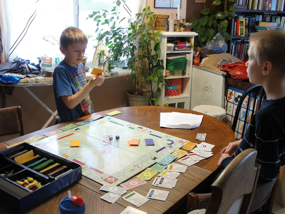 The other boys celebrated the home day by breaking out the Monopoly game before breakfast!