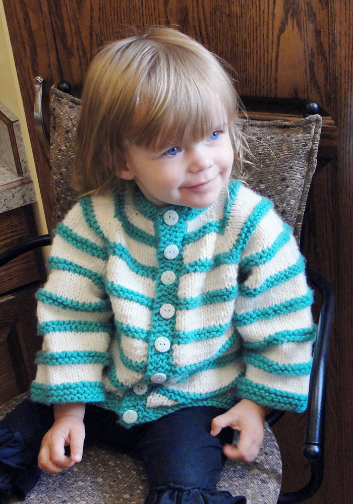 Norah wearing the 24-month long-sleeve version.